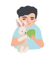 portrait of young man or boy holding his bunny or vector image vector image