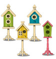 birdhouses on stand green yellow blue bird house vector image vector image