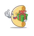 with gift macaroni mascot cartoon style vector image vector image
