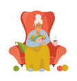 knitting old female sitting in a cozy armchair vector image