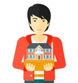 Man holding house model vector image