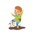 cute boy jumping in dirt cute naughty kid bad vector image