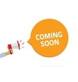 Coming soon sing hand holding vector image