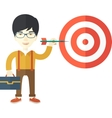 Working chinese man holding a target arrow vector image