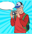 mature man taking picture with camera pop art vector image vector image
