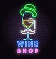 retro neon wine sign on brick wall background vector image
