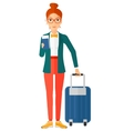 Woman standing with suitcase and holding ticket vector image