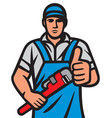 plumber holding a wrench and showing thumbs up vector image vector image