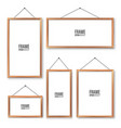 realistic hanging on a wall blank wooden picture vector image vector image