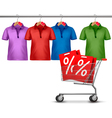 Shirts hanging on a bar and a shopping cart vector image vector image