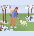 young woman walking and playing with dog in park vector image vector image