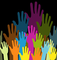 group of color hands on black background vector image