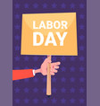 hand holding banner labor day holiday poster vector image
