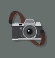 retro camera in a flat style with strap vector image