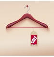 Red tag with sale sign hanging on wooden hanger vector image vector image