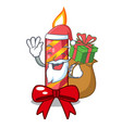 santa with gift decorative christmas candles vector image vector image