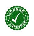 license agreement scratched stamp with tick vector image vector image