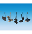 The footwear hanging on a rope vector image
