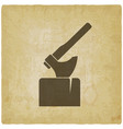 axe in log silhouette on vintage background vector image