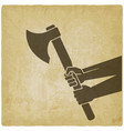 hands holding axe on vintage background vector image vector image
