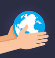 hand holding and guarding planet earth vector image