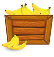 banana on wooden banner vector image vector image