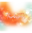 hand drawn happy thanksgiving lettering on blurred vector image vector image