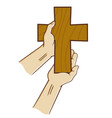 hand holding wooden christian cross vector image