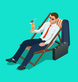 Businessman relaxing on his sun lounger on the