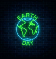 glowing neon sign of world earth day with globe vector image vector image
