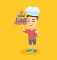 caucasian child in chef hat holding a cake vector image