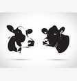 set of two abstract cow heads vector image