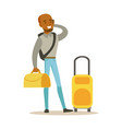 young man standing with yellow suitcases and vector image vector image