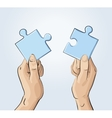 Two hands holding pieces of the puzzle vector image vector image