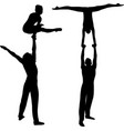 gymnasts acrobats black silhouette on black vector image vector image