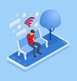 isometric man in free internet zone using mobile vector image
