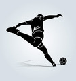 Silhouette kicking footballer vector image vector image