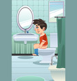 boy sitting on the toilet in the bathroom vector image