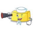 sailor with binocular butter mascot cartoon style vector image vector image