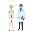 two doctors males and female in medical gowns vector image vector image