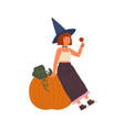 cute girl wearing witch hat hold lollipop and sit vector image vector image