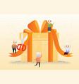elderly people with big gift box vector image
