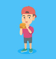 little caucasian boy eating a hamburger vector image