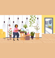 woman with watering can taking care houseplants vector image vector image