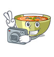 photographer lentil soup on character wooden table vector image vector image