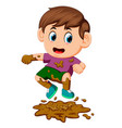 boy jumping in the mud vector image vector image