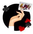 hand of woman holding joker playing card on the vector image vector image