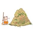 Thai kid sweep the huge pile leaves
