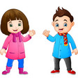 cartoon little girl and boy wearing winter clothes vector image vector image