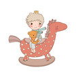 little cute cartoon boy sitting on a rocking horse vector image